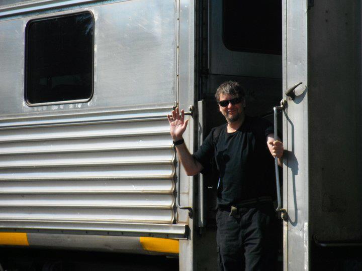 Glen getting off or on train