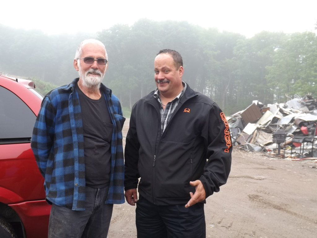 "Jim Lipsit and Greg Long. Lipsit is the Havilland Waste Site operations manager. ""We try to keep as much as possible out of the landfill. We pull out tires and the metals. We have a resuse store too- whatever doesn't go in the landfill is a good thing. There's a lot less coming into the landfill with Greg's business picking up curbside recycling."""