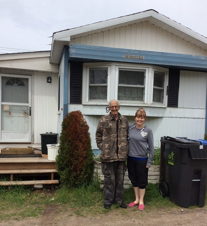 Kindred spirits! Leo and Melody in front of Leo's new digs. Congratulations on being a homeowner Leo!