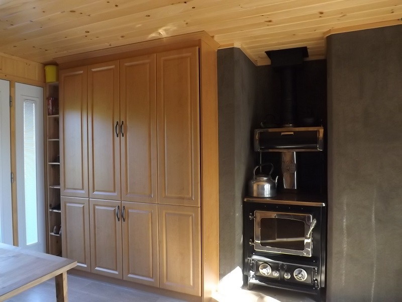 bed and woodstove