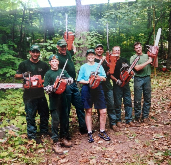 Early Tree Men days. Chopping trees with Dr. Roberta Bondar. Dan pictured in the back. Left front, a young Harrison.