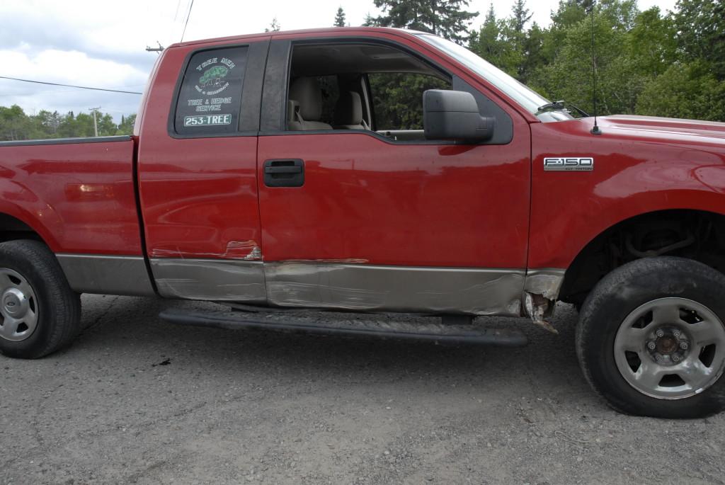 Damage incurred to Tree Men vehicle.