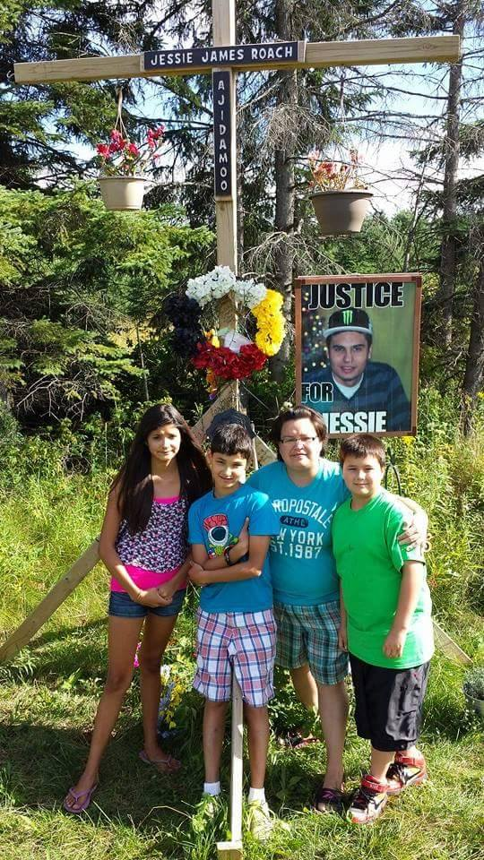 Dawn Roach, Jessie's siblings and cousin at his memorial site on Highway 17B in Garden River First Nation.