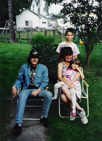 Eric Mearow, background. Chieanne's parents and Chieanne on mom's knee.