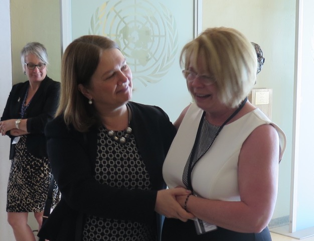 Minister of Health, Jane Philpott, comforts Donna May after an emotional speech before the UN.